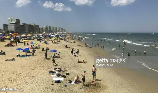Beach Goers Enjoy The Waterfront In Virginia June 11 2017 Afp Photo