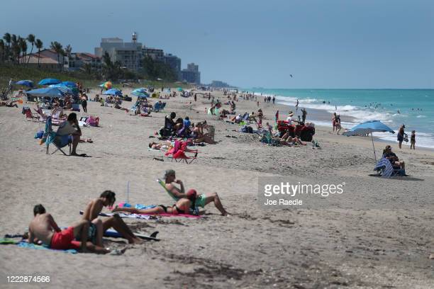 Beach goers enjoy the weather on May 04 2020 in Jensen Beach Florida Restaurants retailers as well as beaches and some state parks reopened today...