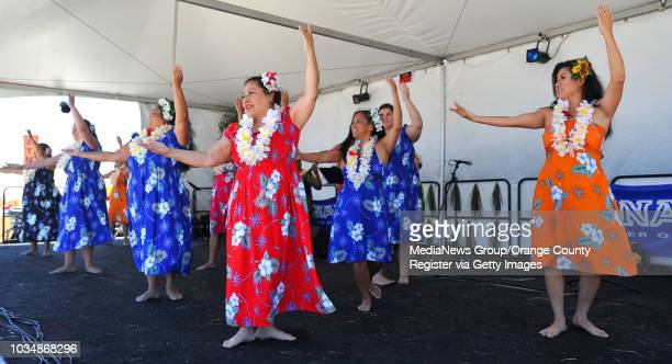 BEACH Beach goers get their tiki on as the 12th annual Tiki Beach Festival took place at the foot of Granada Avenue in Belmont Shore Hula dancers...