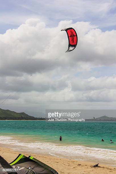Beach Goers in Swimsuits Enjoy Watching Recreation Kiteboarding and Kayakers in the Pacific Ocean With The Mokapu Penninsula in the Distance at the...
