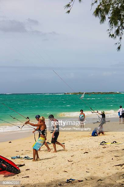 Beach Goers in Swimsuits Enjoy Watching Recreation Kiteboarding Windsurfing and Kayakers in the Pacific Ocean With Flat Island in the Distance at the...