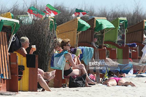 Beach goers lie in beach baskets in hot weather on a sunny day on the south beach of Duene Island on August 4 2013 near Helgoland Germany Duene...