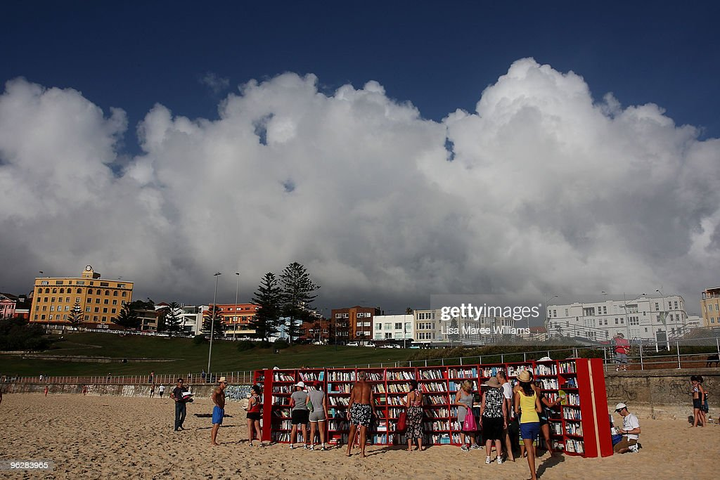 Beach goers select books from 30 red Ikea Billy bookcases lined up to form the world's longest outdoor bookcase to celebrate the 30th birthday of the brand's signature furniture piece, at Bondi Beach on January 31, 2010 in Sydney, Australia. The bookcases were filled with thousands of books which beachgoers can swap for one of their own or make a gold coin donation to buy, with proceeds to The Australian Literacy & Numeracy Foundation.
