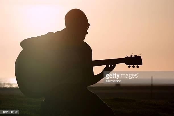beach guitarist - midi pyrénées stock photos and pictures