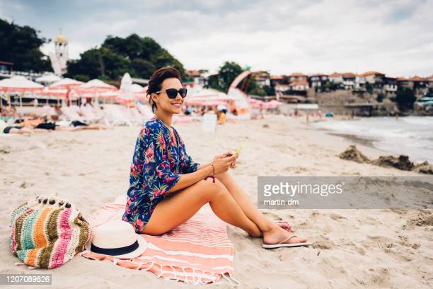 beach holiday - tunic stock pictures, royalty-free photos & images