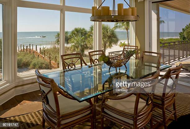 beach house dining room with beautiful view of shore - lee county florida stock photos and pictures