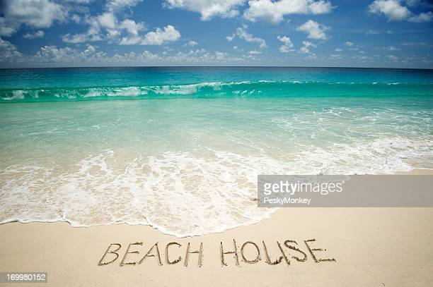 Beach House Message on Bright Tropical Sand
