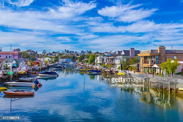 Beach houses and recreational boats at Newport Beach, CA (P)