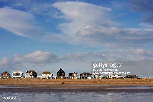 beach houses, camber sands - camber sands stock photos and pictures