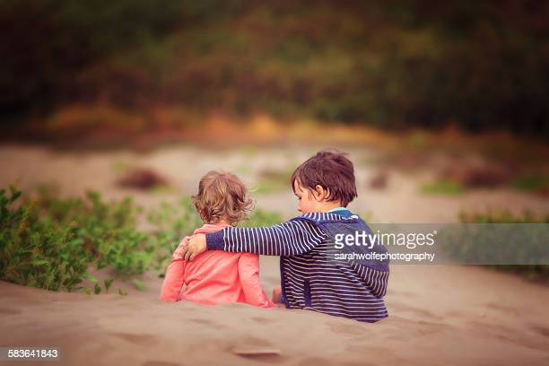 beach hugs - consoling stock pictures, royalty-free photos & images