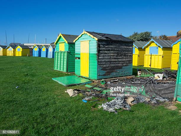 beach hut destroyed fire in felpham, west sussex - west sussex stock pictures, royalty-free photos & images