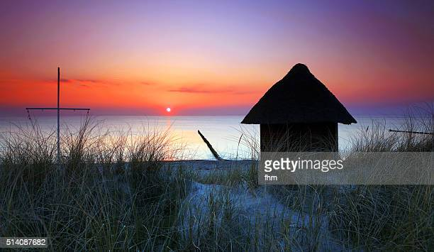 Beach hut near baltic sea in sunset, for the lifeguards and their equipment