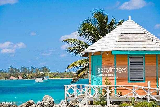 beach hut on the beach, nassau, bahamas - nassau stock photos and pictures