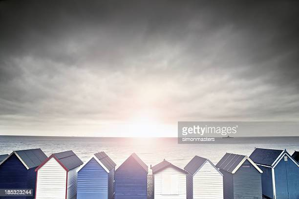 beach hut sunset