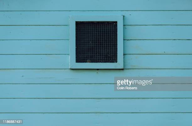 a beach hut window - beach hut stock pictures, royalty-free photos & images