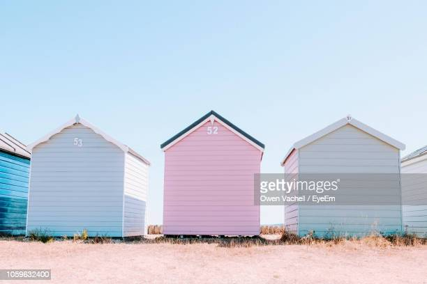 beach huts against clear sky - beach hut stock pictures, royalty-free photos & images