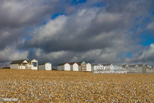 Beach huts against clody sky