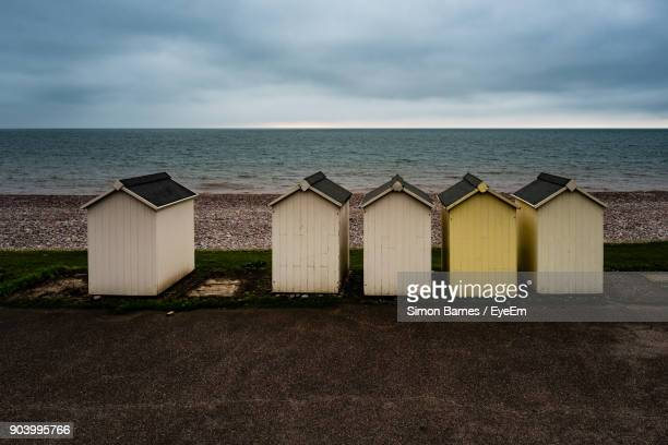 Beach Huts Against Sea