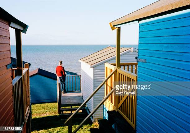 beach huts and sky - contemplation stock pictures, royalty-free photos & images