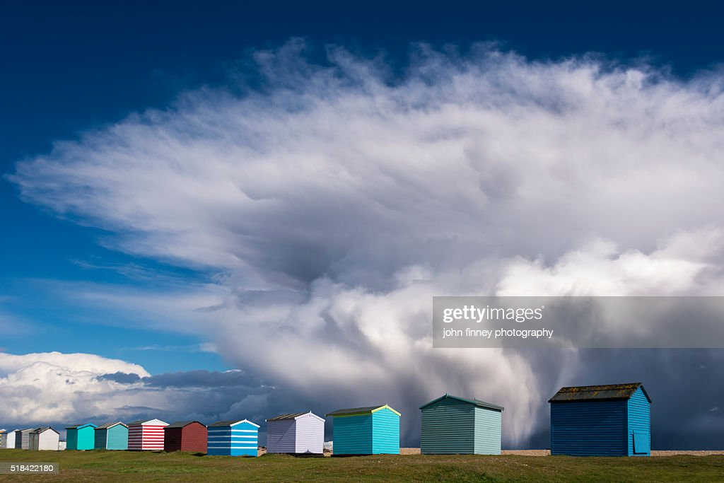 Beach huts and Storm katie. : Stock Photo