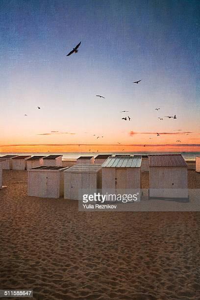 Beach huts at sunset