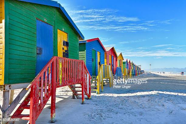 Beach huts beside the surf at Muizenberg beach
