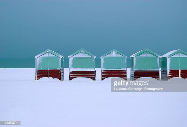 Beach huts in snow on Hove seafront