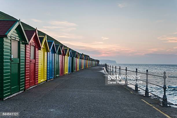 beach huts in whitby, england, uk - whitby north yorkshire england stock pictures, royalty-free photos & images