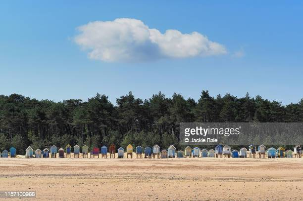 beach huts on holkham beach - east anglia stock pictures, royalty-free photos & images