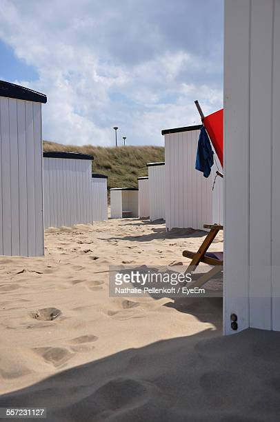 beach huts on sand against cloudy sky - nathalie pellenkoft stock pictures, royalty-free photos & images
