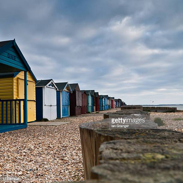 beach huts - ian grainger stock pictures, royalty-free photos & images
