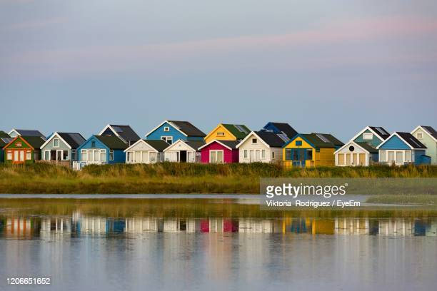 beach huts - holiday villa stock pictures, royalty-free photos & images