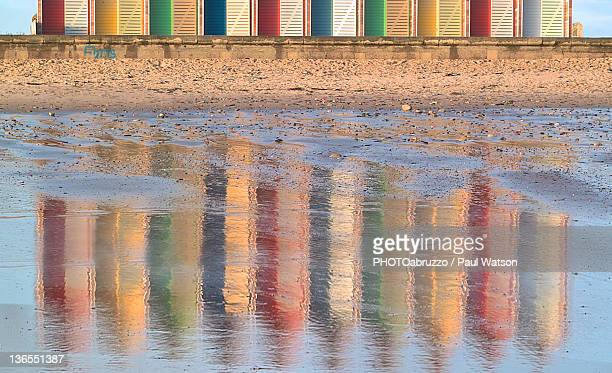beach huts reflection on northumbrain coast - blyth northumberland stock pictures, royalty-free photos & images