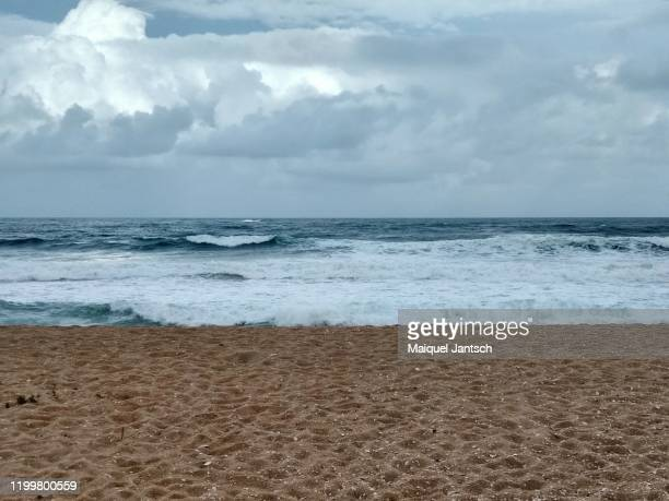beach in a cloudy day - rocky coastline stock pictures, royalty-free photos & images