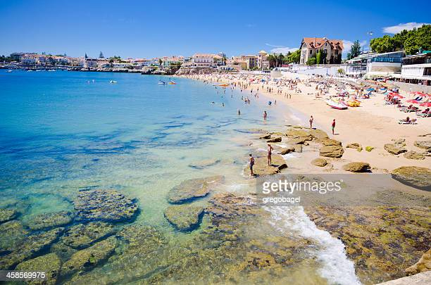 beach in cascais, portugal on a hot summer day - cascais stock photos and pictures