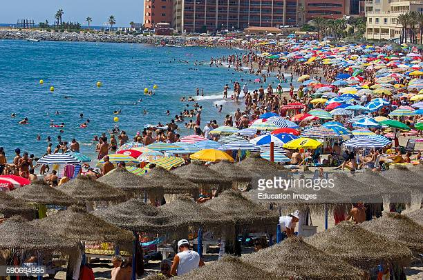 Beach in high season Benalmadena Malaga province Costa del Sol Andalusia Spain