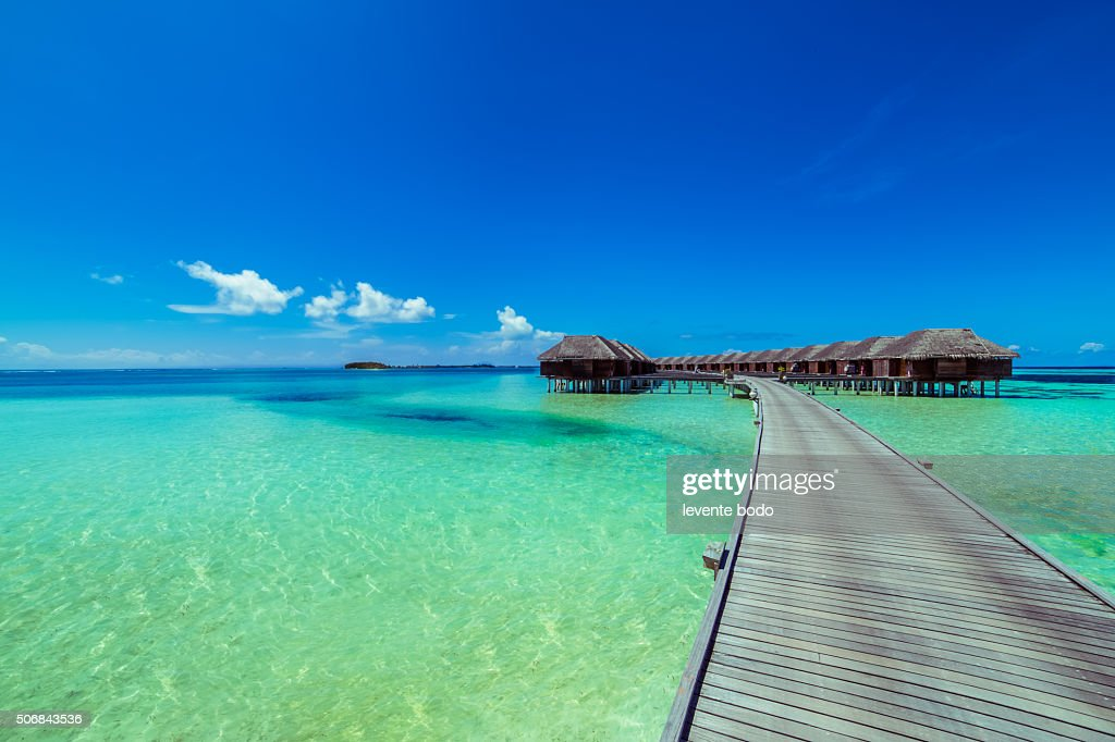 Beach in Maldives and blue lagoon : Stock Photo