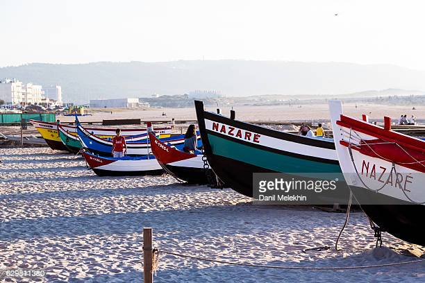 beach in nazare portugal - leiria district stock photos and pictures