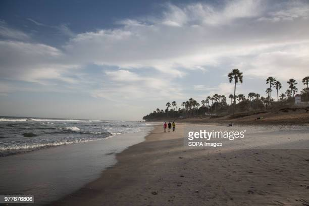 A beach in Serrekunda Gambia where many young men go to run or play football and locals nicknamed bumsters are also known to wait to hassle tourists...