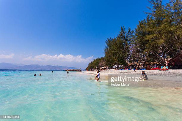 beach in the gili islands in lombok, indonesia - gili trawangan stock photos and pictures