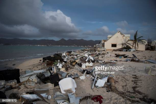 A beach is littered with rubble in the Baie Nettle area of Marigot on September 10 2017 on SaintMartin island devastated by Hurricane Irma People on...