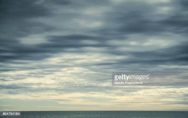 beach landscape in fog, morning - bedeckter himmel stock-fotos und bilder