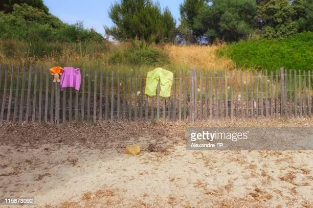Beach laundry on wooden ganivelles at Cote d'azur