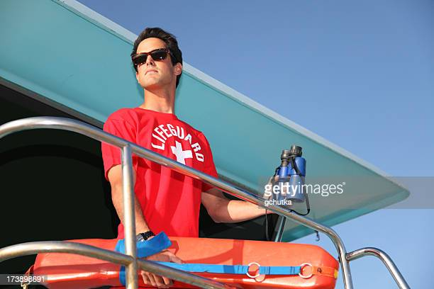 beach lifeguard on tower - lifeguard stock pictures, royalty-free photos & images
