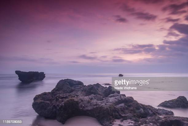 beach long exposure beach at sunset - made widhana stock photos and pictures