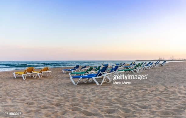 beach loungers - spain stock pictures, royalty-free photos & images