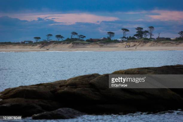 beach near josé ignacio lighthouse, punta del este city, uruguay - jose ignacio lighthouse stock photos and pictures