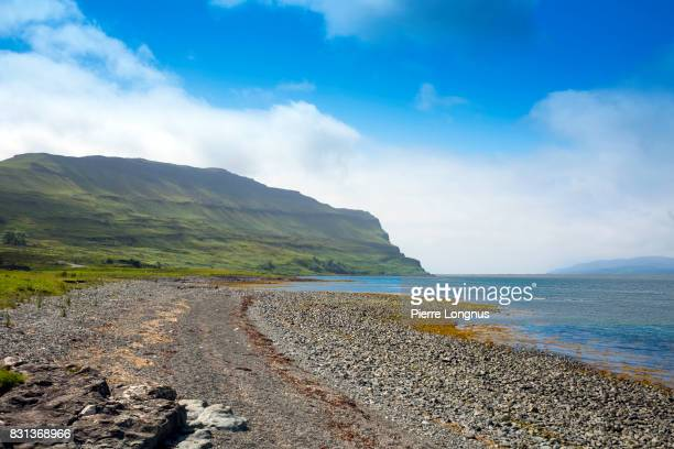 beach near the ben more mountain trail on loch na keal, principal sea loch on atlantic coastline of the island of mull, in the inner hebrides, argyll and bute, scotland. - western isles stock pictures, royalty-free photos & images