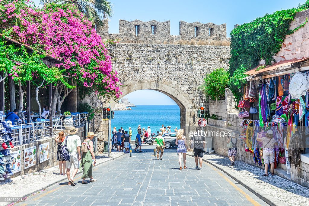 Beach next to castle walls in Rhodes, Greece : Stock Photo