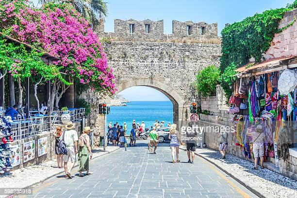 Beach next to castle walls in Rhodes, Greece